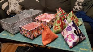 Fabric boxes and assorted triangle pouches