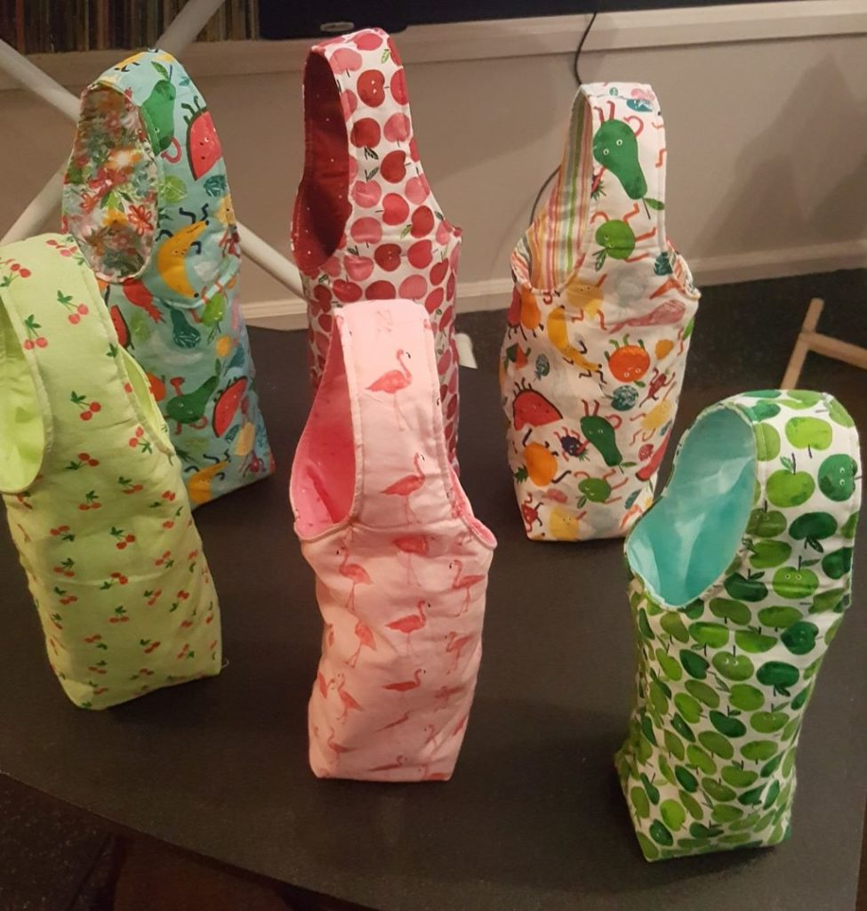 Six wine bags, fruit and flamingo themed