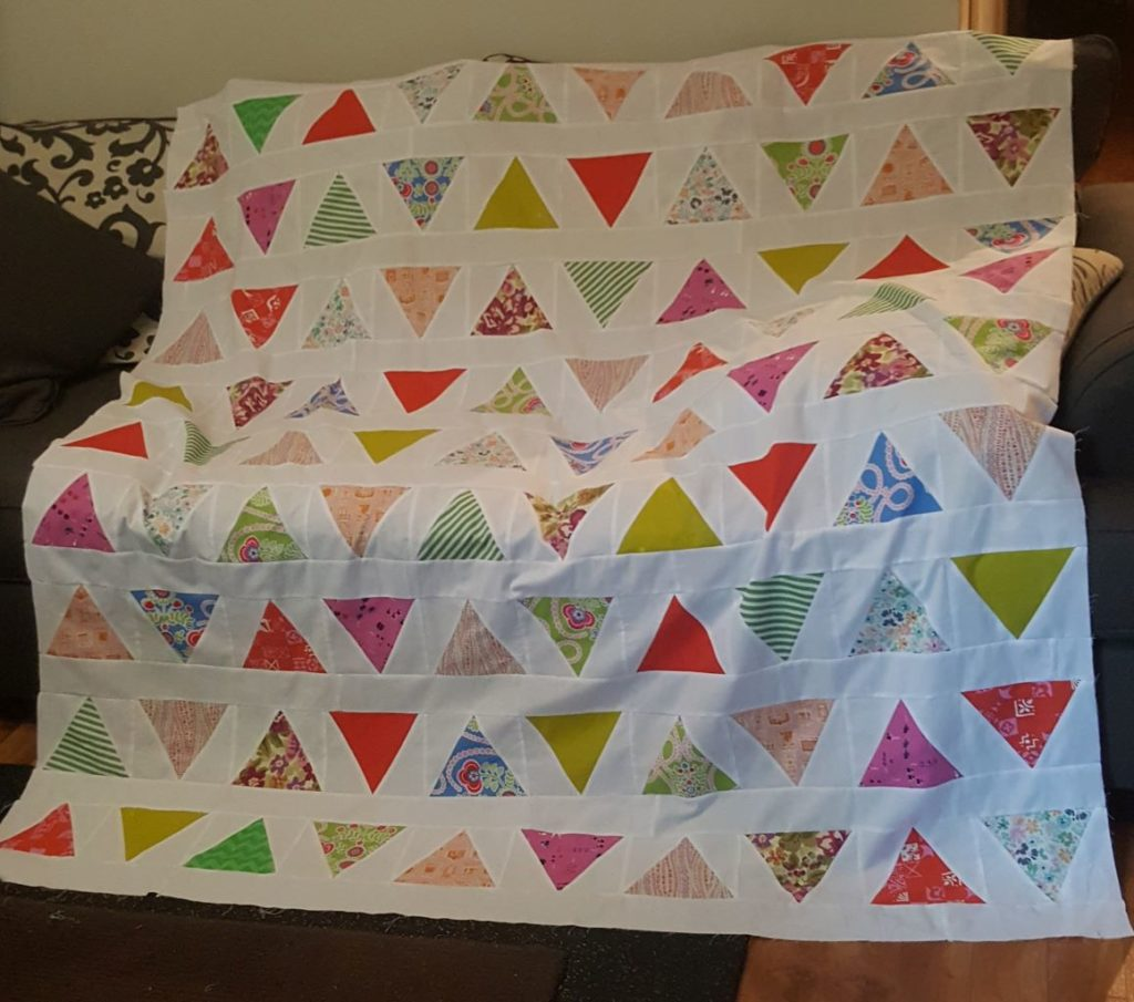 Triangle Pop Pattern quilt top. Pattern by Emily Dennis