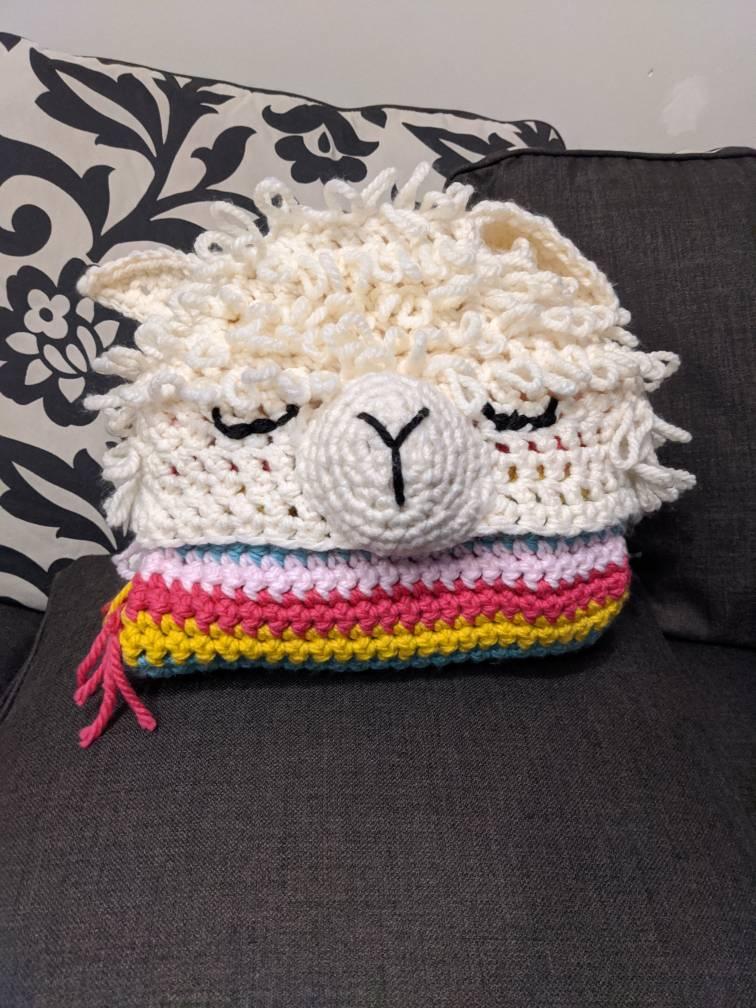 Folded up llama hoodie blanket.