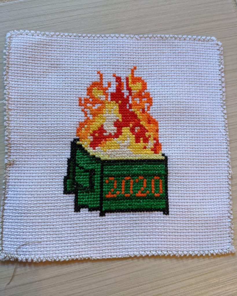 Cross stitch work of a 2020 dumpster fire