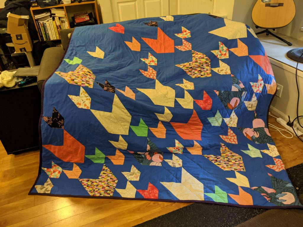 Finished Pacific Crest quilt on a couch